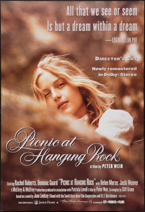 movie poster for picnic at hanging rock in dreamy sepia toned hues featuring a girl with wind in her hair and the photograph is shot from below and she's peeking over a rock face