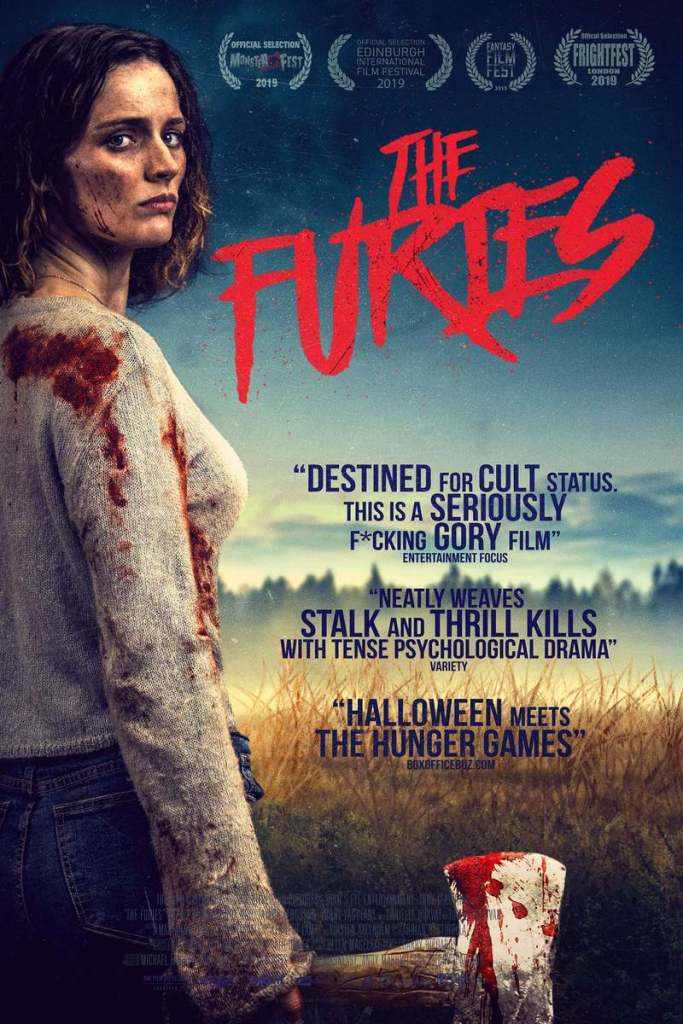 movie poster for the furies featuring the australian outback with the main female character left justified in frame holding a bloody axe with blood on her shoulder and dirt on her face