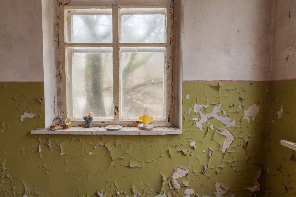 Window in abandoned kindergarten with old cracky walls. Chernobyl, Ukraine